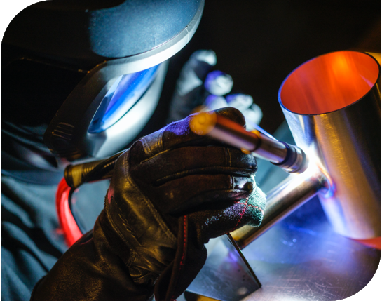 man performing a tig weld
